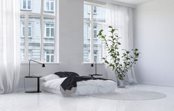 Modern monochromatic white bedroom interior Stock Image