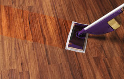 Modern mop for cleaning wooden floor from dust Stock Images
