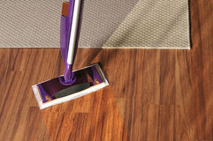 Modern mop for cleaning wooden floor from dust Royalty Free Stock Images