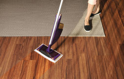 Modern mop for cleaning wooden floor from dust Stock Photos