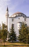 Modern mosque in the park. Snow-white modern mosque in the park Royalty Free Stock Photography