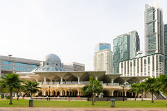 Modern mosque between skyscraper Stock Photography