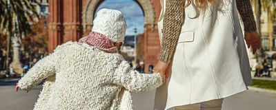 Modern mother and daughter in Barcelona, Spain walking Stock Photo