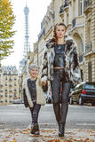 Modern mother and daughter in Paris, France going forward Stock Photos