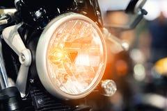 Modern motorcycle headlight woth bokeh in night city street. Royalty Free Stock Photo
