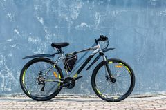 The modern  mountain bicycle near an ancient colored wall stock images