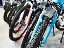 Modern mountain bikes in sports shop Stock Photos