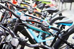 Modern mountain bikes in sports shop. Row modern mountain bikes in sports shop royalty free stock image