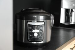 Modern multi cooker in kitchen. Domestic appliance stock image