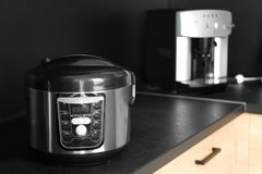 Modern multi cooker in kitchen, space for text royalty free stock photography