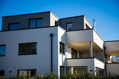 Modern multi family house in munich, blue sky. Cubus stock image