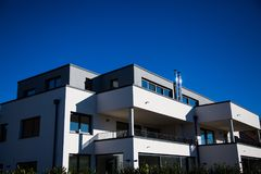 Modern multi family house in munich, blue sky. Germany stock photo