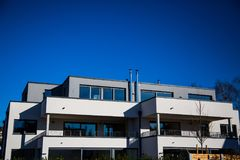 Modern multi family house in munich, blue sky. Germany royalty free stock image