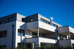 Modern multi family house in munich, blue sky. Germany royalty free stock photography