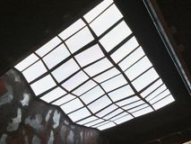 Surreal Multi Pane Skylight Roof. A modern multi glass pane skylight roof and ceiling, with surrealist type shape and apparent distortion. An architectural stock images