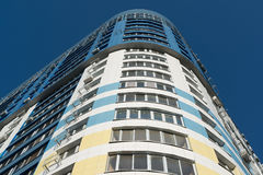 modern multi-storey residential building on background of blue sky Stock Photography