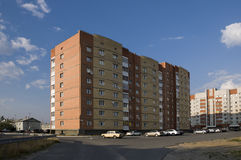 Modern multi-storeyed house with flats. Was built from yellow and orange color Stock Photos