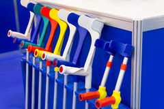 Modern multicolored crutches in the store Royalty Free Stock Photography