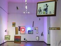 MODERN MUSEUM EXHIBIT, CUENCA. Museo Municipal de Arte Moderno exhibit, hanging artwork suspended from ceiling in Cuenca Ecuador stock photos