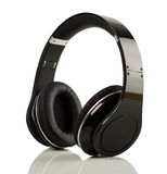 Modern music headphones on white Stock Photos
