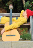 Modern musician posing with his guitar Royalty Free Stock Photos