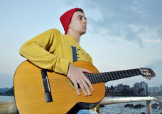 Modern musician posing with his guitar Royalty Free Stock Image