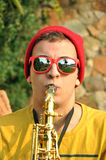 Modern musician posing with his saxophone Stock Photo