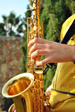 Modern Musician Posing With His Saxophone Royalty Free Stock Image