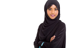 Modern Muslim woman. Looking at the camera over white background Royalty Free Stock Images