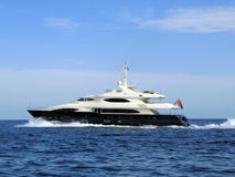 Modern MY. Medium sized modern Motor yacht making passage Stock Images