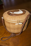 A modern Nantucket Lightship basket. The first Lightship Baskets were made in the mid-to-late 1800 aboard the lightship stationed on Nantucket Shoals. Originally Royalty Free Stock Images