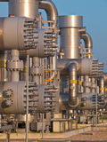 Modern natural gas processing plant. Detail of a modern natural gas processing plant during sunset Royalty Free Stock Photography