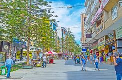 In modern neighborhood of Antalya. ANTALYA, TURKEY - MAY 12, 2017: The modern shopping neighborhood of the city is popular among the tourists, looking for sales Royalty Free Stock Image