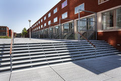Modern neighborhood with metal pavement. In the Katendrecht district in Rotterdam, the Netherlands Royalty Free Stock Images