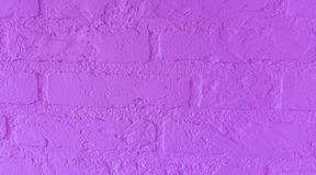 Modern neon purple stone brick wall with big bricks close up background pattern stock photography