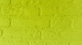 Modern neon yellow stone brick wall with big bricks close up background pattern stock photos