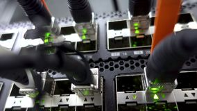 Modern network switch with cables. Server room. Flashing LED Lights close up. Concept 3.0 stock video