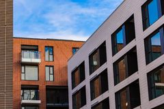 Modern and new apartment building. Multistoried, modern, new and stylish living block of flats. Real estate. New house. Newly. Built block of flats stock photography