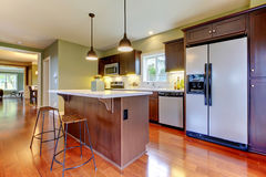 Modern new brown kitchen with cherry floor. Royalty Free Stock Photography