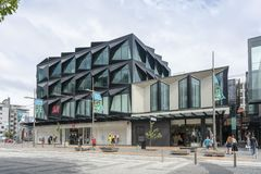 Modern new clothing store building in Christchurch royalty free stock photography