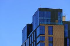 Modern office building over blue sky Royalty Free Stock Photo