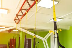 Modern new gym in the fitness center to practice a new sport of the TRX loop, metabolic. Modern new gym in the fitness center to practice a new sport of the TRX stock photo