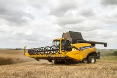 Modern New Holland Combine Harvester Cutting Crops Royalty Free Stock Photography
