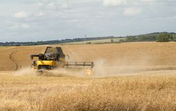 Modern New Holland combine harvester cutting crops Stock Photos