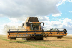 Modern New Holland combine harvester cutting crops Stock Photo
