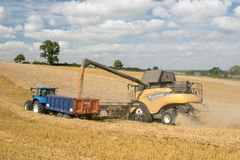 Modern New Holland combine harvester cutting crops Stock Images