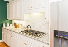 Modern New Kitchen with Granite Countertops Royalty Free Stock Images