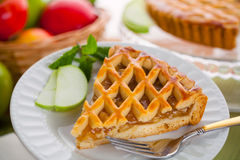 Modern new recipe apple tart pie holiday snack treat served on a plate Royalty Free Stock Photos