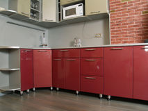 Modern new red kitchen with brilliant surfaces Royalty Free Stock Images