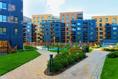 Modern new residential apartment house building complex outdoor facilities bench stock photo
